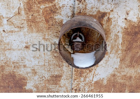 Rusty metal door with protected lock, place for copyspace - stock photo