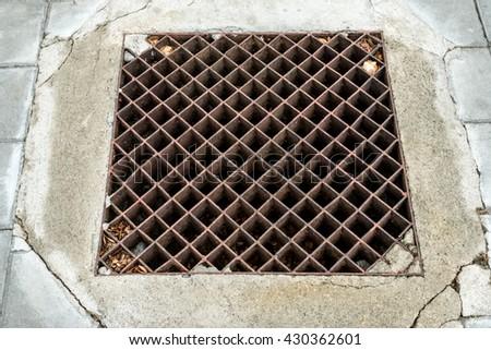 Rusty metal drain cover - stock photo