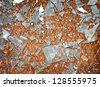 Rusty metal floor with shards of broken glass - the background - stock photo