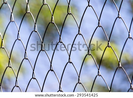 Rusty metal grille fence macro and nature background