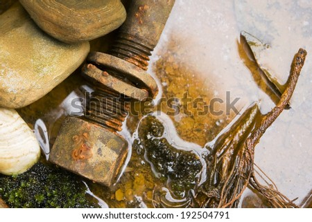 Rusty metal in water - stock photo