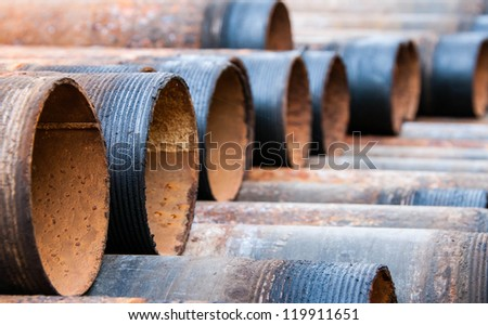 Rusty metal pipes - stock photo