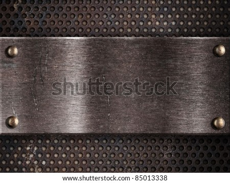 rusty metal plate on grid background - stock photo