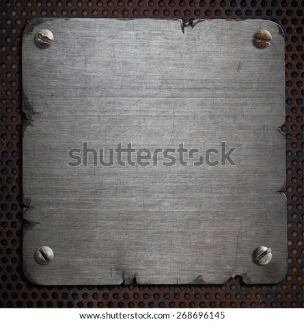 rusty metal plate with torn edges background - stock photo