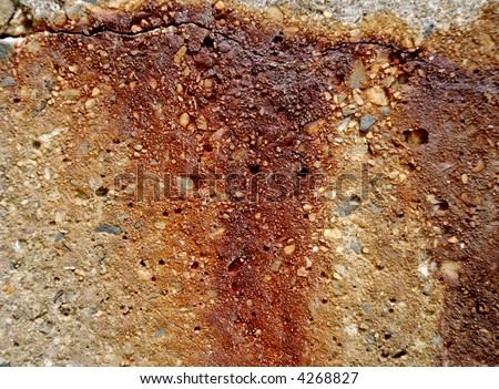 Rusty metal staining concrete texture