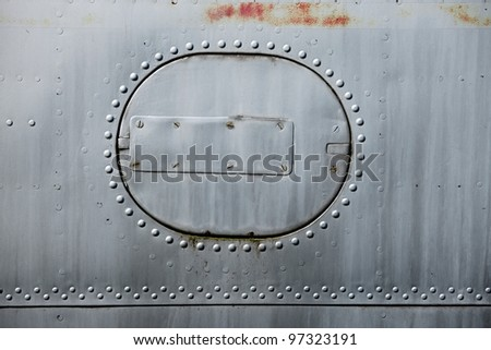 Rusty metal surface of an old aircraft - stock photo