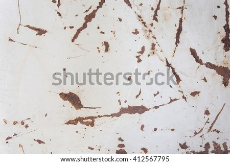 rusty metal surface with cracked white paint. Textured background - stock photo