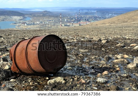 Rusty metallic barrel. Industrial area. - stock photo