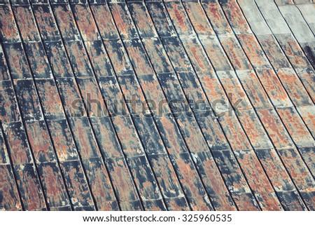 Rusty metallic roof pattern outside - stock photo