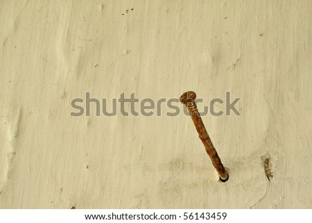 Rusty nail and an old wall - stock photo