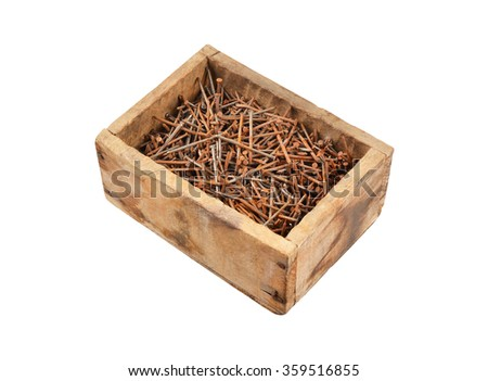 Rusty nail in wooden box, isolated on white background - stock photo