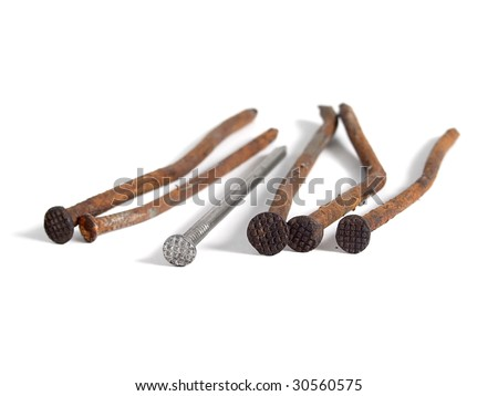 Rusty nails over white - stock photo
