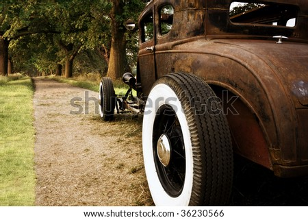rusty old car - stock photo