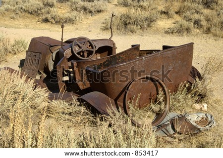 Rusty old car in a ghost town in California. - stock photo