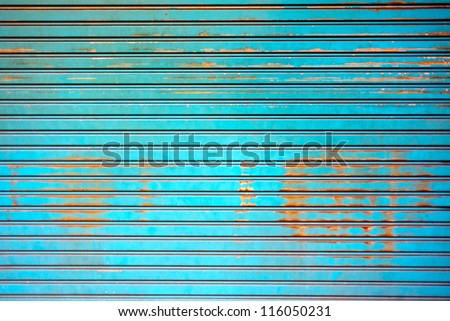 Rusty old corrugated iron fence close up. - stock photo