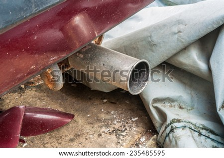 rusty old exhaust pipe - stock photo