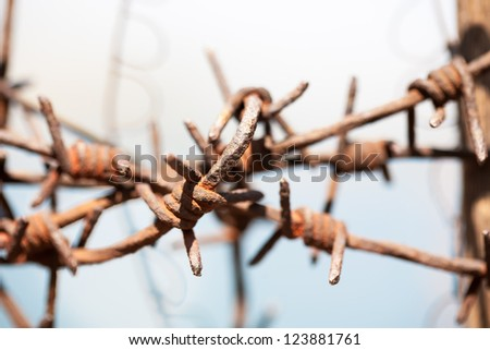 Rusty old fences of barb wire that got tangled together. - stock photo