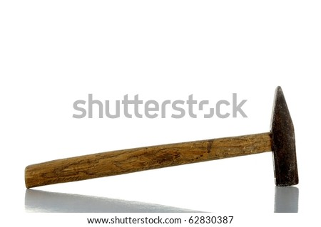 rusty old hammer with reflection - isolated on white