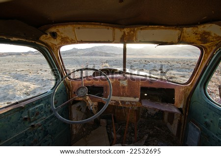 Rusty, old interior of deserted truck in Captiol Reef National Park - stock photo