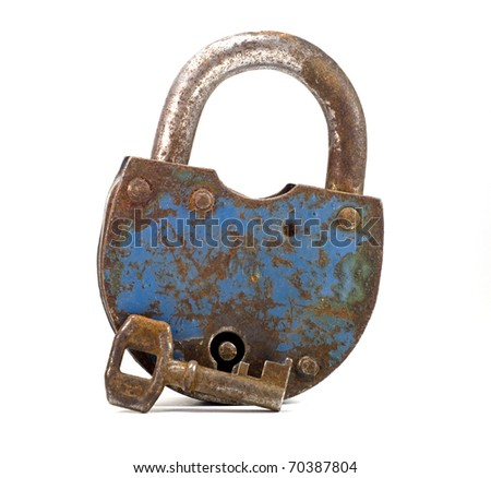 Rusty old lock with the key on white background - stock photo