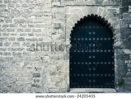 Rusty old medieval entrance, creepy mood. - stock photo