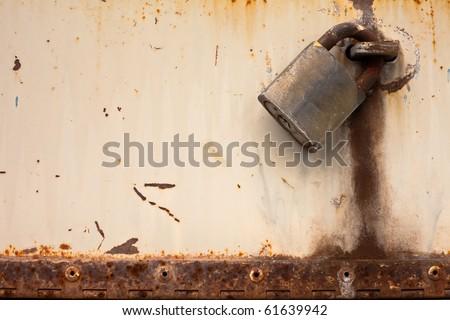 Rusty old padlock. - stock photo