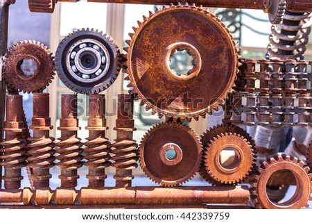 Rusty old parts gears bearing reducer - stock photo