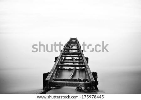 rusty old pier - stock photo