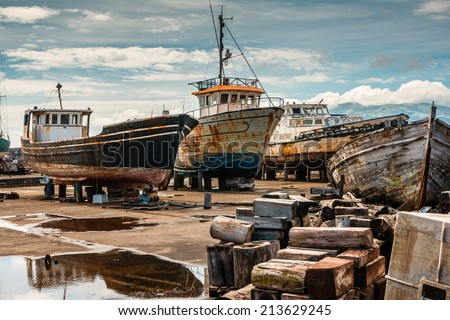 Rusty old retired boats on the boatyard of Madalena-Pico-Azores - stock photo