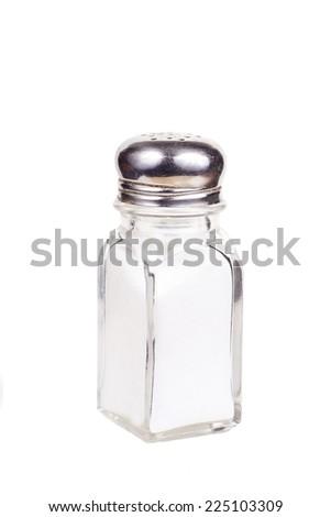 Rusty old salt shaker with salt - stock photo