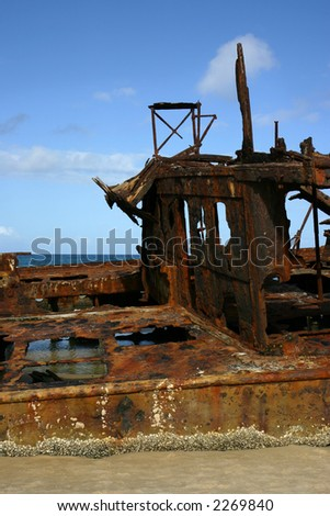 Rusty old ship wreck on the beach (Fraser Island, Australia) - stock photo