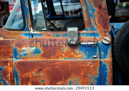 Rusty old truck with drive-in movie theater speaker - stock photo