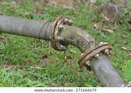 Rusty Old  Water Pipe Connector - stock photo