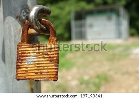 rusty pad lock - stock photo