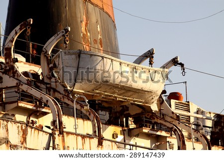 Rusty passenger ship abandoned - stock photo