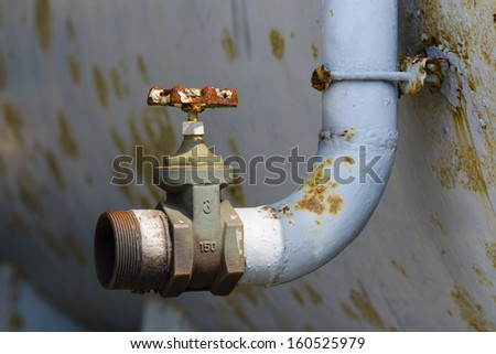 Rusty pipe and valve.