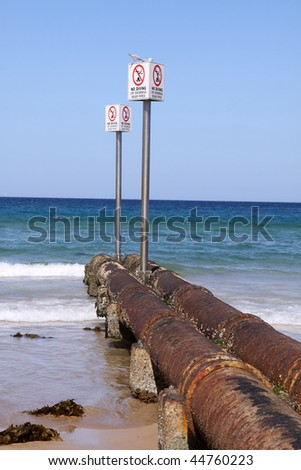 Rusty pipes at australian beach - stock photo