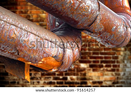 Rusty pipes, through many years. - stock photo