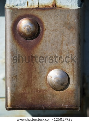 Rusty Plate and Bolts - stock photo