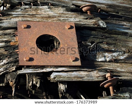 Rusty plate on old wood plank  - stock photo