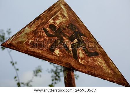 rusty road sign children. Shallow depth of field. grungy image - stock photo