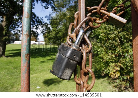 Rusty school gate chained and padlocked