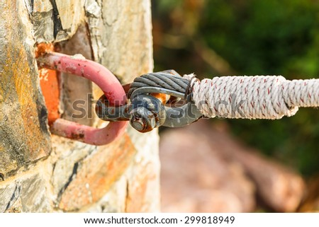 rusty shackle connect the sling and rope tied knot in nature background