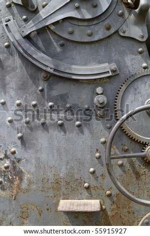 rusty sheet metal with rivets and gears - stock photo