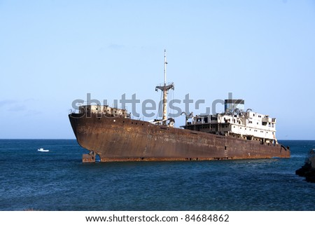 rusty ship on the shore in Lanzarote, Canary Islands, Spain - stock photo