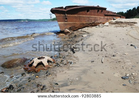 rusty ship on the shore of  Ob river in Russia - stock photo