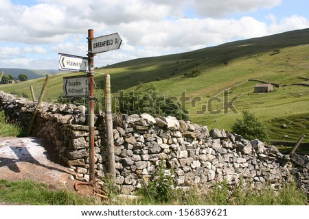 Rusty sign post pointing to places in the Yorkshire Dales - stock photo
