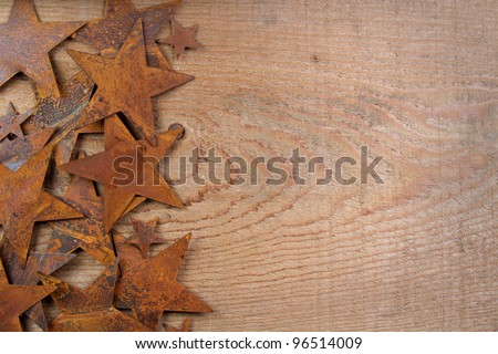 Rusty stars on a wooden background, room for copy space - stock photo