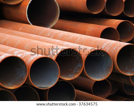 Rusty steel pipes. - stock photo