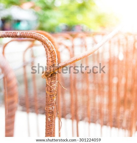 Rusty steel rods or bars used to reinforce concrete - stock photo